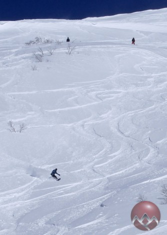 Dropping the Kozonosawa bowl from the peak with 30cms of fresh powder in Niseko